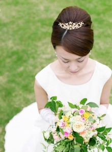 Pensive Bride Holding Her Bouquet